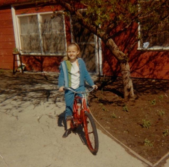 debbie beck on her red bike